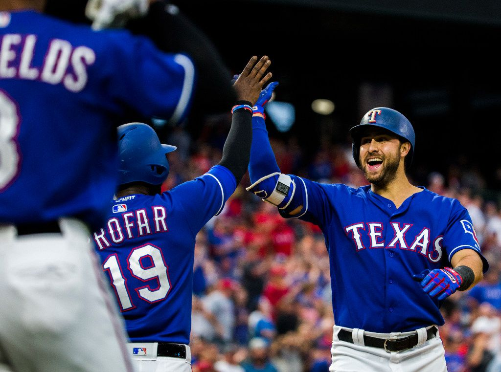 Texas Rangers third baseman Joey Gallo (13) celebrates his 2-run home run with shortstop Jurickson Profar (19) and left fielder Delino DeShields (3) during the second inning of an MLB game between the Texas Rangers and the Kansas City Royals on Friday, April 21, 2017 at Globe Life Park in Arlington, Texas. (Ashley Landis/The Dallas Morning News)