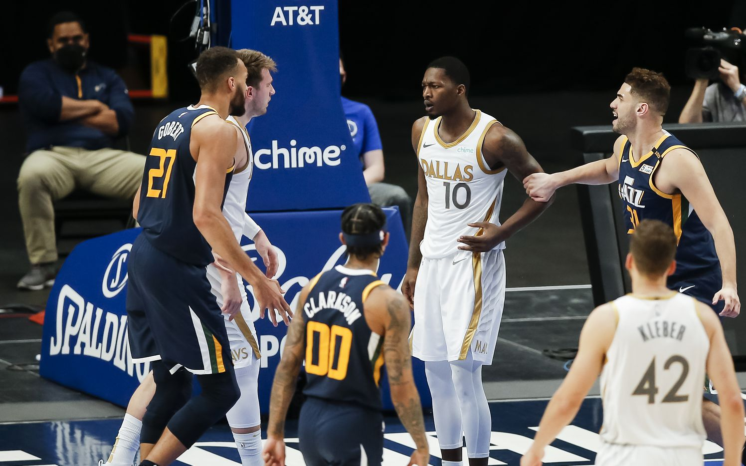 Utah Jazz forward Rudy Gobert (27) and Dallas Mavericks forward Dorian Finney-Smith (10) are separated by teammates after a brief scuffle during the second half of an NBA basketball game in Dallas, Monday, April 5, 2021. (Brandon Wade/Special Contributor)