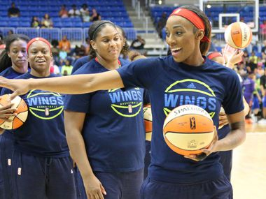 Dallas Wings forward Glory Johnson (25) waves to a fan before the Dallas Wings vs. Phoenix Mercury WNBA basketball game at the UTA College Park Center in Arlington, Texas on Thursday, August 10, 2017.