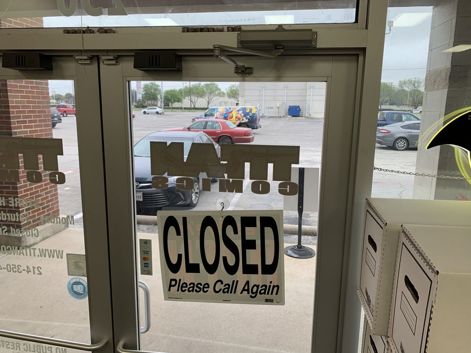 The doors of Titan Comics at Forest Lane and Webb Chapel Road as the store prepared to close under Dallas County's coronavirus emergency.