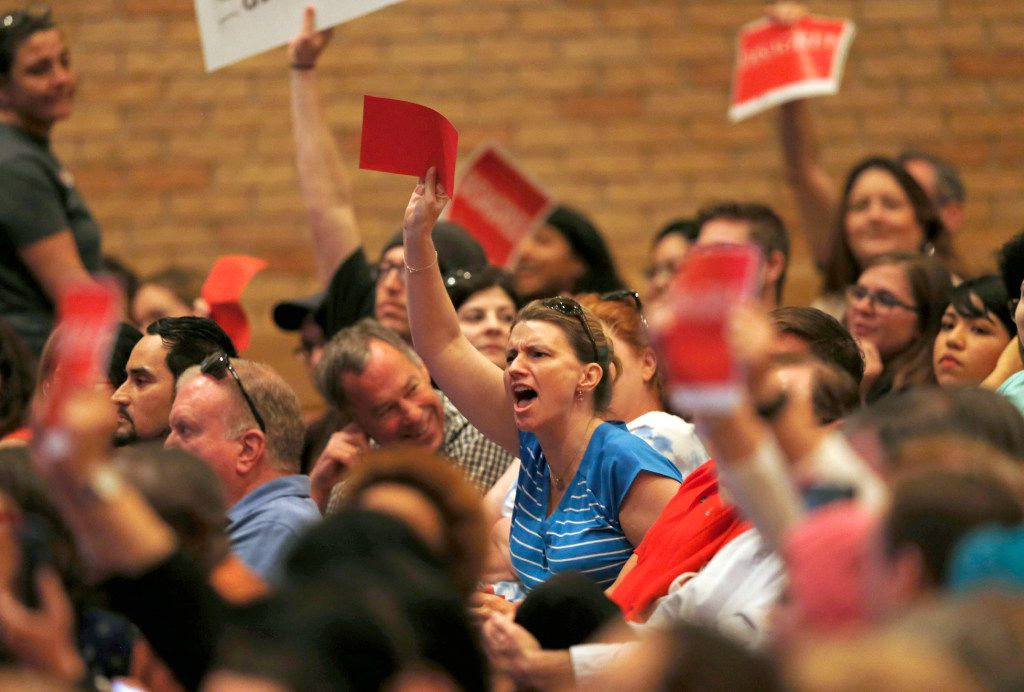 People voice their opinion during a town hall meeting with Rep. Pete Sessions, R-Dallas in the auditorium of Richardson High School in Richardson on Saturday, March 18, 2017. (Vernon Bryant/The Dallas Morning News)