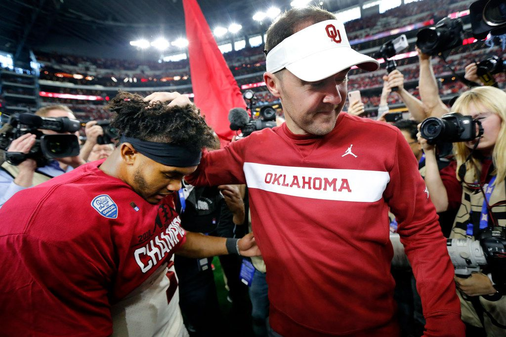Oklahoma Sooners quarterback Kyler Murray (left) is congratulated by head coach Lincoln Riley after defeating the Texas Longhorns in the Big 12 Championship at AT&T Stadium in Arlington, Texas, Saturday, December 1, 2018. Joining in on the celebration is safety Robert Barnes (20). The Sooners defeated the Longhorns, 39-27. (Tom Fox/The Dallas Morning News)