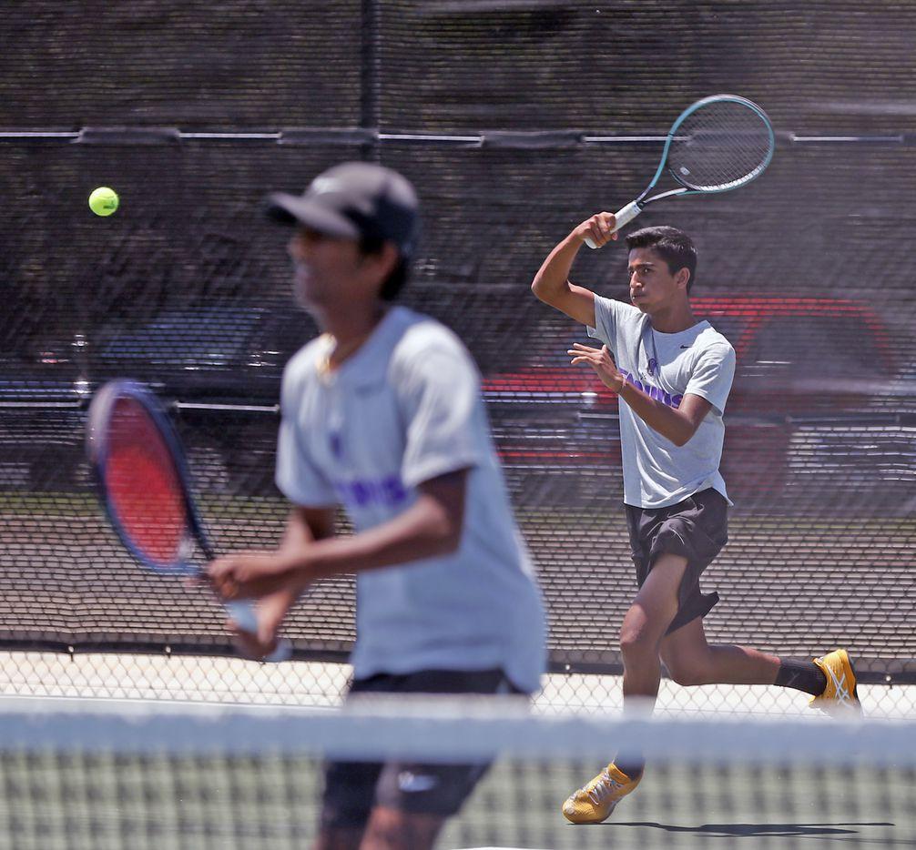 Frisco Independence's Sansh Kumar serves as Sanjaya Kodali waits in a boys 5A doubles match. UIL state tennis semifinals at Northside ISD Tennis Center on Thursday, May 20, 2021.