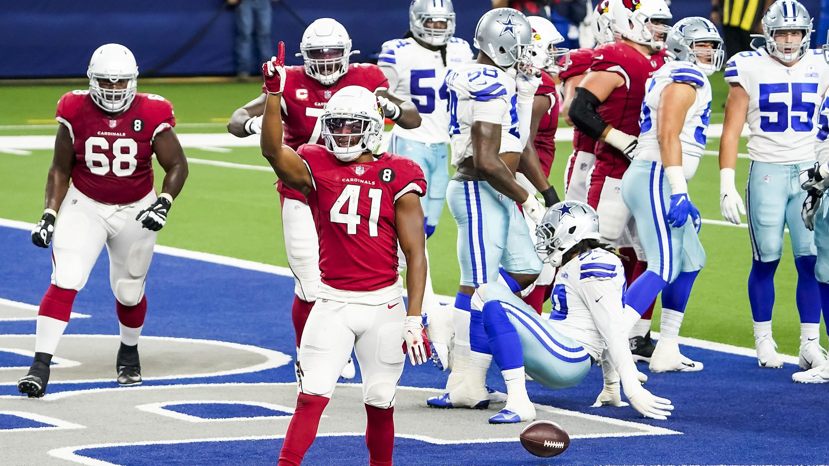 Arizona Cardinals running back Kenyan Drake (41) celebrates after scoring on a touchdown  run during the second quarter of an NFL football game against the Dallas Cowboys at AT&T Stadium on Monday, Oct. 19, 2020, in Arlington.