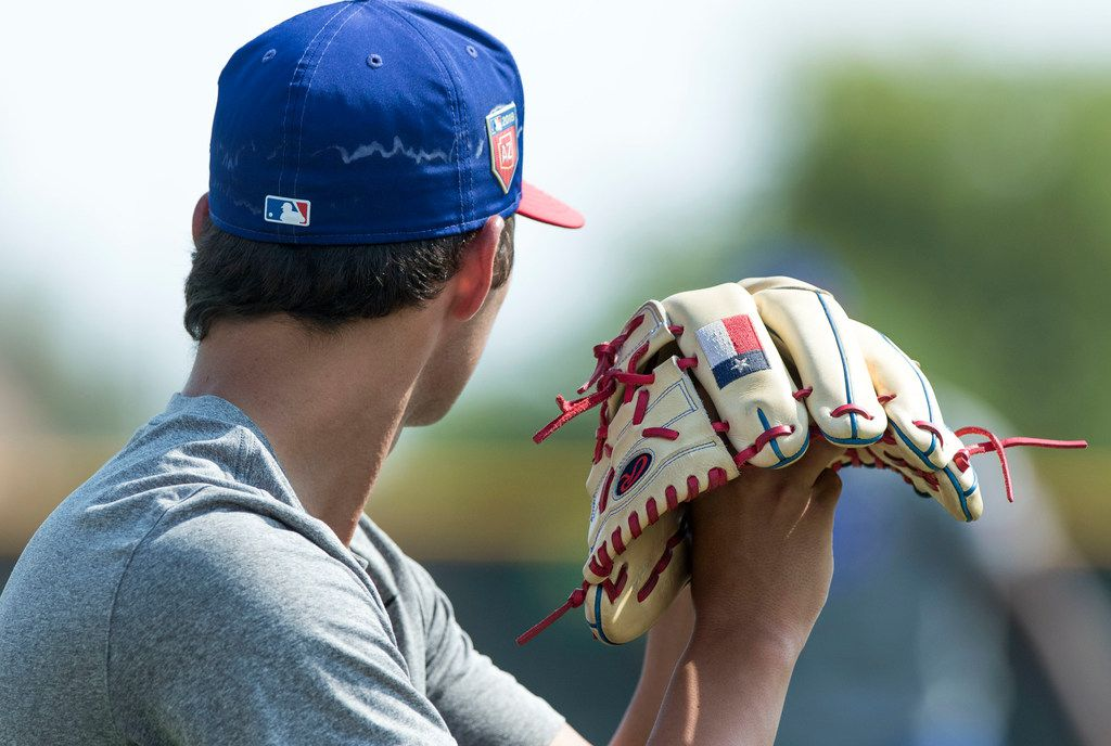 """Texas Rangers' pitcher Owen White works on his delivery while doing a little long toss with teammate Cole Winn at Rangers' training facility Thursday, Aug. 9, 2018 in Surprise, Arizona. The players are learning from a program that is designed to hopefully prevent injury, part designed to allow for more learning of """"feel"""" for the game.(Darryl Webb/Special Contributor)"""