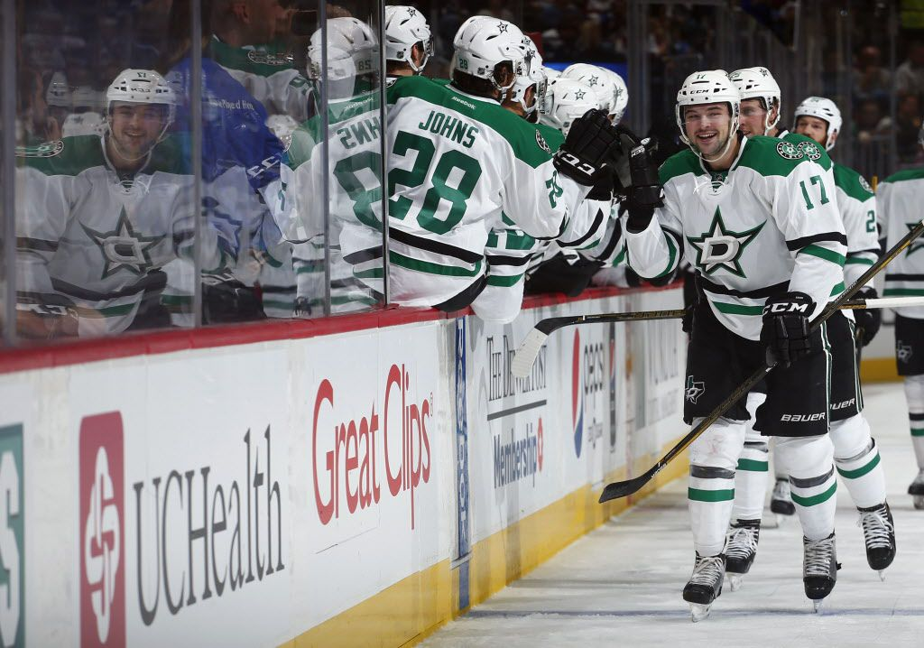Dallas Stars center Devin Shore celebrates a goal with teammates on the bench against the Colorado Avalanche during the first period of an NHL hockey game, Saturday, Oct. 15, 2016, in Denver. (AP Photo/Jack Dempsey)