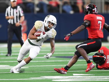 LUBBOCK, TX - NOVEMBER 24: Running back John Lovett #7 of the Baylor Bears tries to get past defensive back Jah'Shawn Johnson #7 of the Texas Tech Red Raiders during the second half of the game on November 24, 2018 at  AT&T Stadium in Arlington, Texas. Baylor defeated Texas Tech 35-24. (Photo by John Weast/Getty Images)