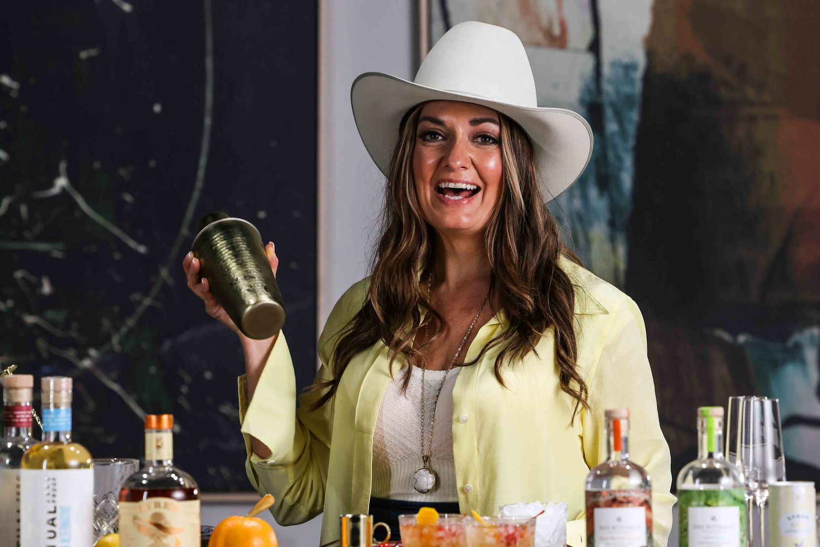 Beth Hutson, a beverage professional and creator of The Elevated Elixir, mixes up a drink at Lowtown Studios in Fort Worth.