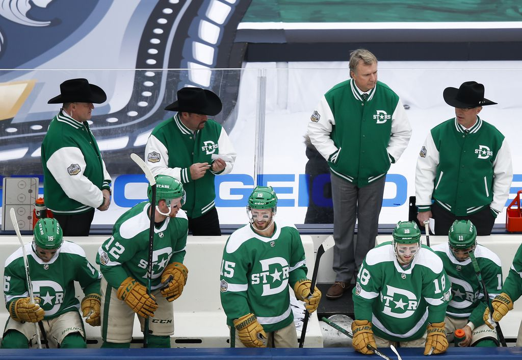 Dallas Stars interim head coach Rick Bowness, second from top right, works the bench during the third period of a NHL Winter Classic matchup between the Dallas Stars and the Nashville Predators on Wednesday, January 1, 2020 at Cotton Bowl Stadium in Dallas. (Ryan Michalesko/The Dallas Morning News)