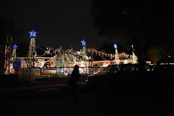 Cars line the street near Joel Occhiuzzo's annual Holiday Express Riding Train in Richardson.