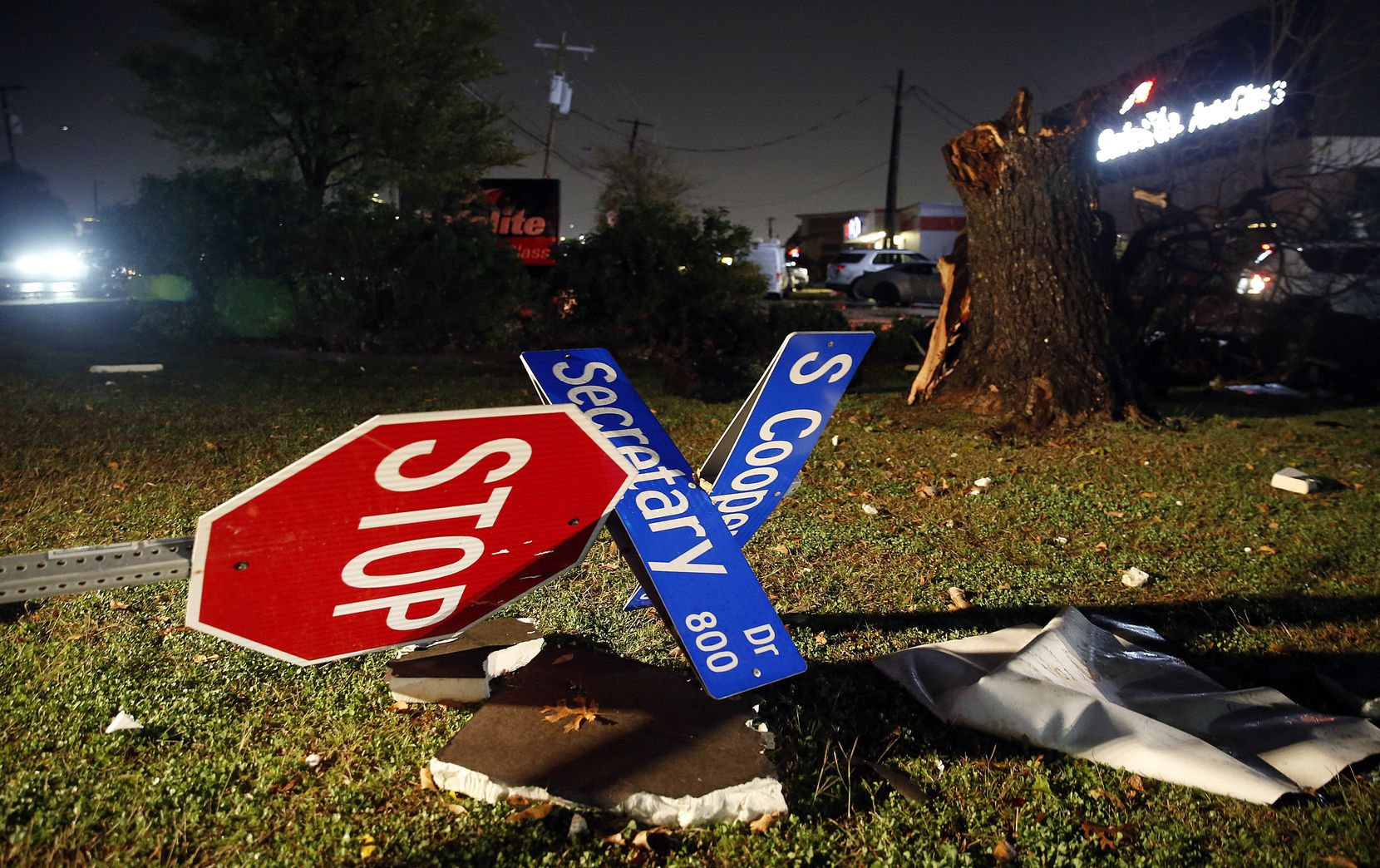 The street sign on Cooper St. at Secretary Dr. was blown over in Arlington when a tornado-warned storm blew through, Tuesday night, November 24, 2020. No one was seriously injured across the street at the Burger Box restaurant.