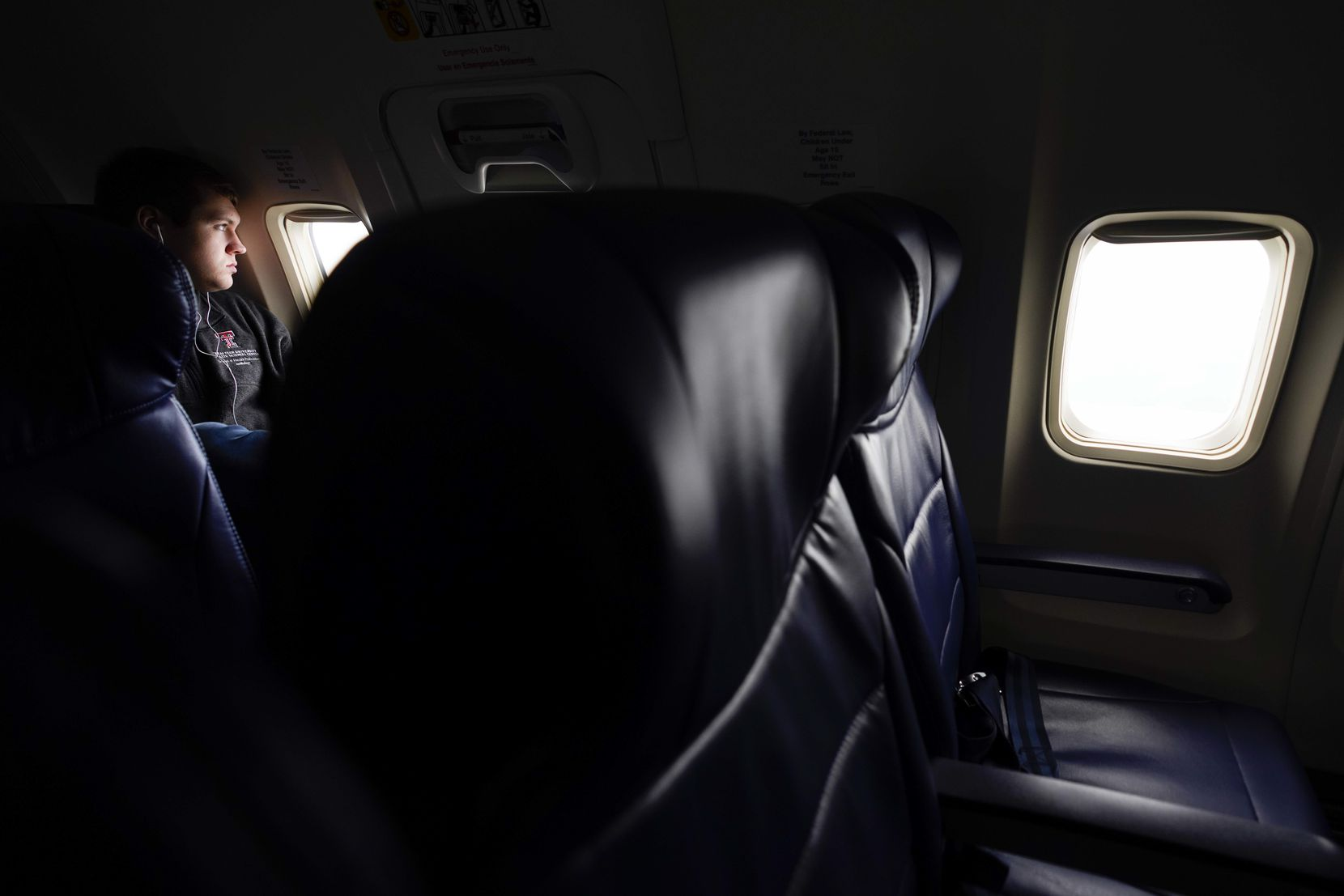 """Langdon Gund, a student at Texas Tech University studying for his doctorate in audiology at the School of Health Professions, had multiple rows to himself on a Southwest Airlines flight from Dallas Love Field to Houston Hobby on March 20, 2020.  The 737-700, configured to accommodate 143 passengers, carried fewer than 50, including passengers from a canceled previous flight to Houston. Gund was returning home to Beaumont and elected to fly for $58 instead of making the roughly 10-hour drive. """"I waited so long because we have to work in the clinic at the school, and they wouldn't cancel it. They finally canceled it yesterday."""""""