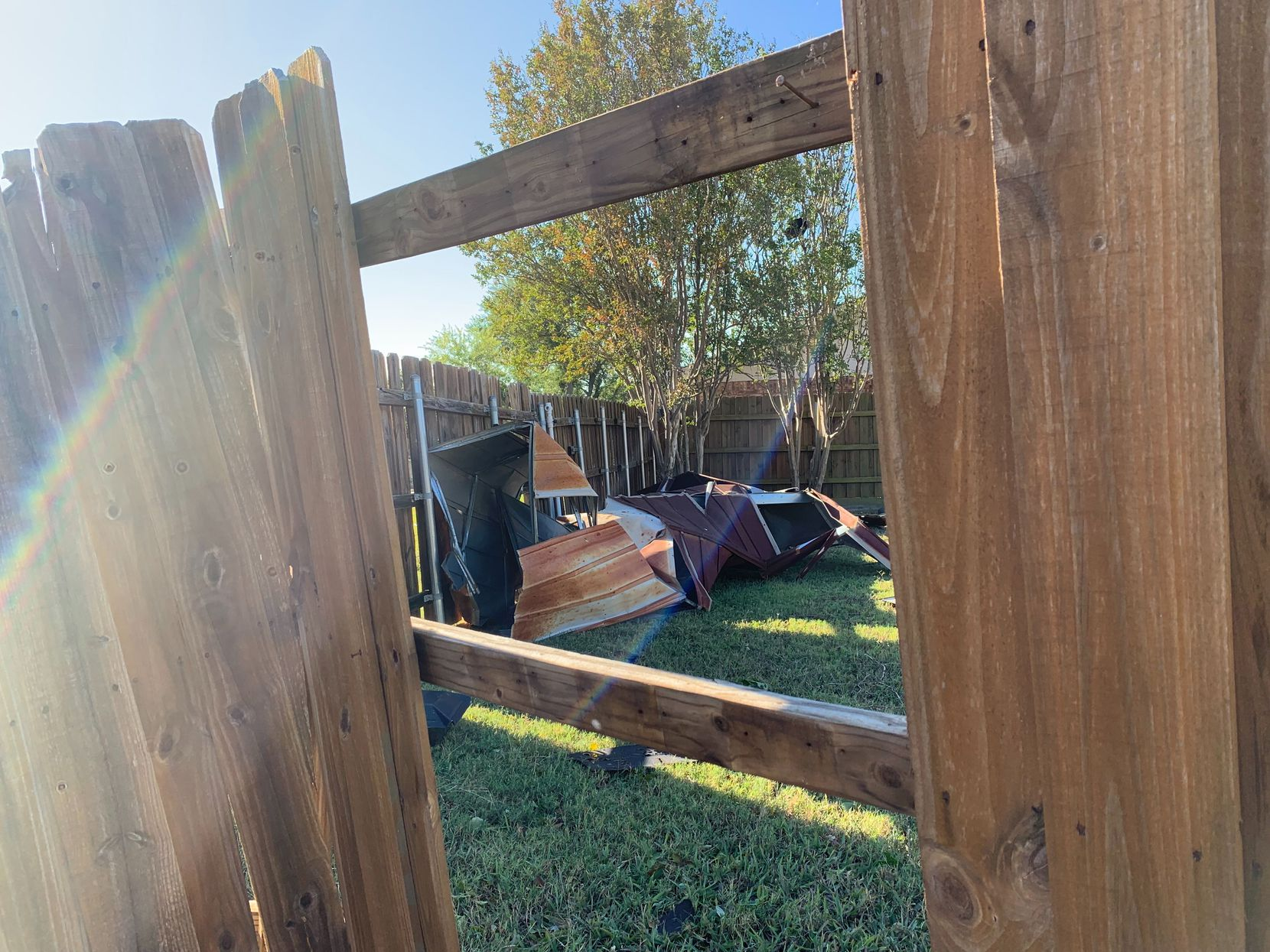 Maria Luisa Garbe of Richardson said she in thankful her neighbors weren't injured and that her home suffered only minor damage. Her neighbors' homes are missing roofs and have extensive water damage. Their homes might not be livable, she said. This photo of her fence and a shed that fell into her yard were taken Monday, October, 21, 2019.