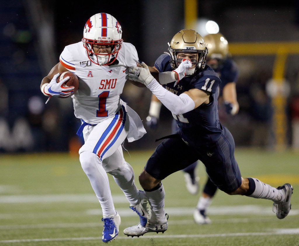 Southern Methodist Mustangs wide receiver CJ Sanders (1) gives Navy Midshipmen safety Evan Fochtman (11) a stiff arm as he races around the end during the second quarter at Navy-Marine Corps Memorial Stadium in Annapolis, Maryland, Saturday, November 23, 2019. (Tom Fox/The Dallas Morning News)