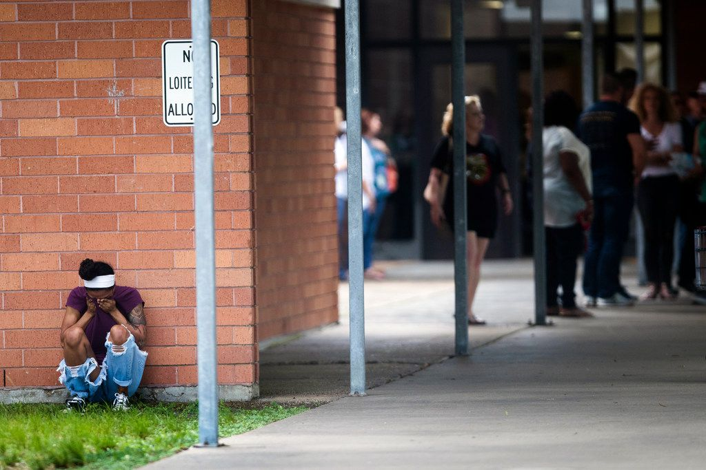 People gathered by the Barnett Intermediate School following the shooting at Santa Fe High School in Santa Fe, Texas., in May. A new bill would give school districts an extra $50 per student to improve security.
