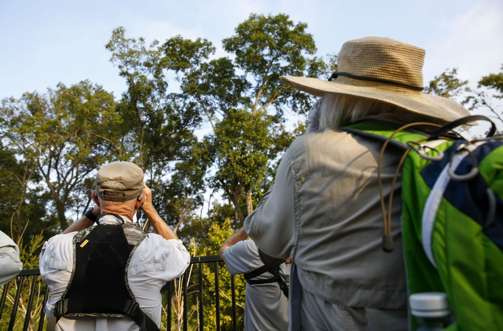 Members of the Prairie and Timbers Audubon Society Chapter of McKinney scan the trees for birds while taking a guided nature tour at the Joppa Preserve in the Trinity Forest in Dallas Saturday September 21,  2019.
