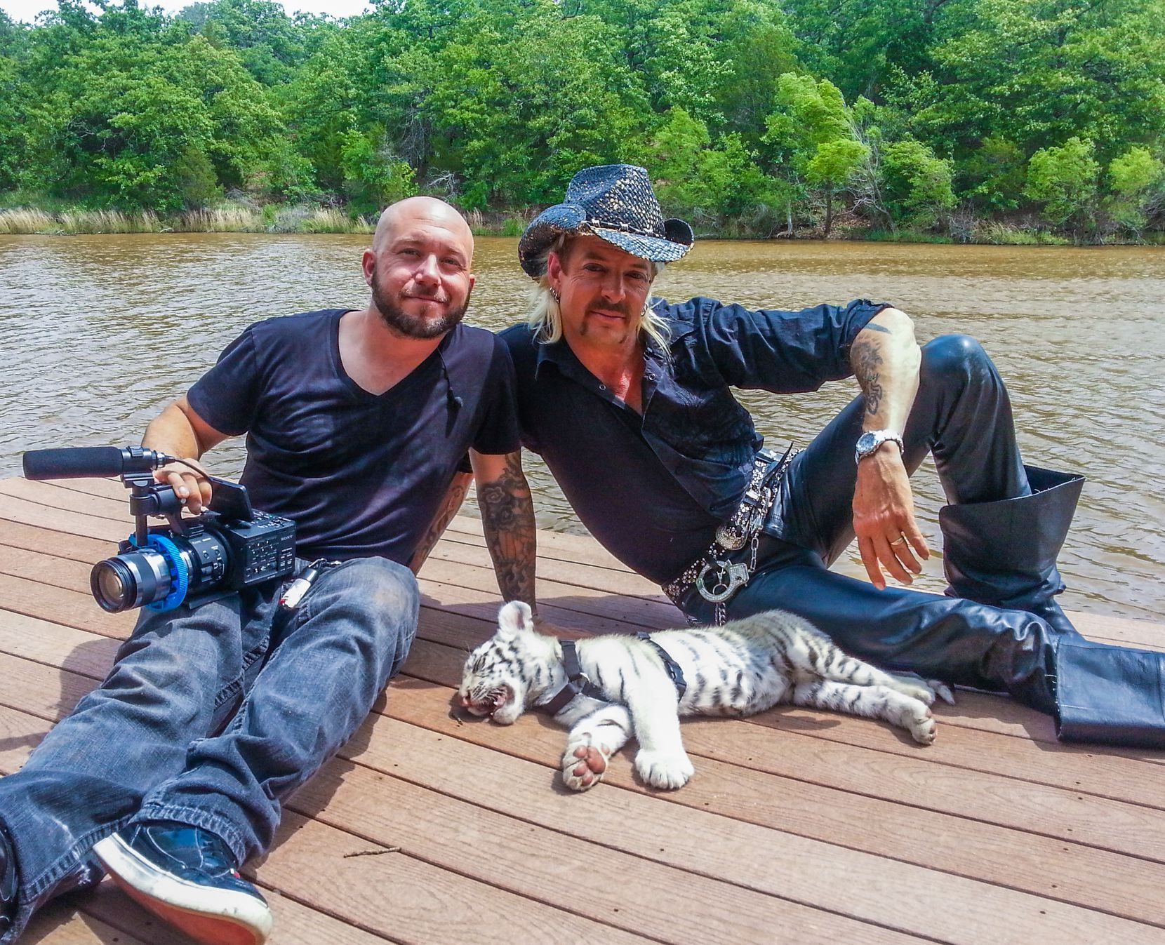 JT Barnett (left) spent several months filming with Joe Exotic from 2012 to 2014 and even shot some of his country music videos.