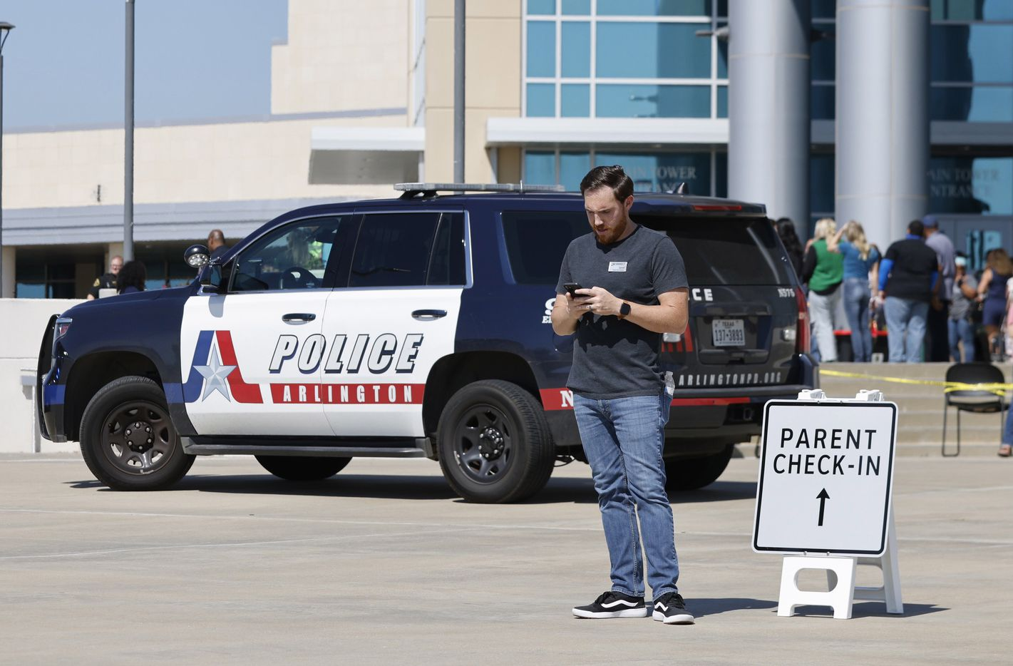 Parents of Timberview High School students wait outside of the Mansfield ISD Center for The Performing Arts on Wednesday, October 6, 2021 in Mansfield, TX.Four people were injured in a shooting at Timberview High School in Arlington on Wednesday morning, and authorities said the suspect remained at large.  (Elias Valverde II/The Dallas Morning News)