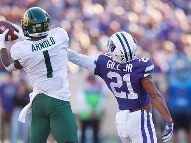 Baylor cornerback Grayland Arnold (1) grabs a pass intended for Kansas State wide receiver Wykeen Gill (21) in the fourth quarter at Snyder Family Stadium in Manhattan, Kan., on Saturday, Oct. 5, 2019. Baylor won, 31-12.