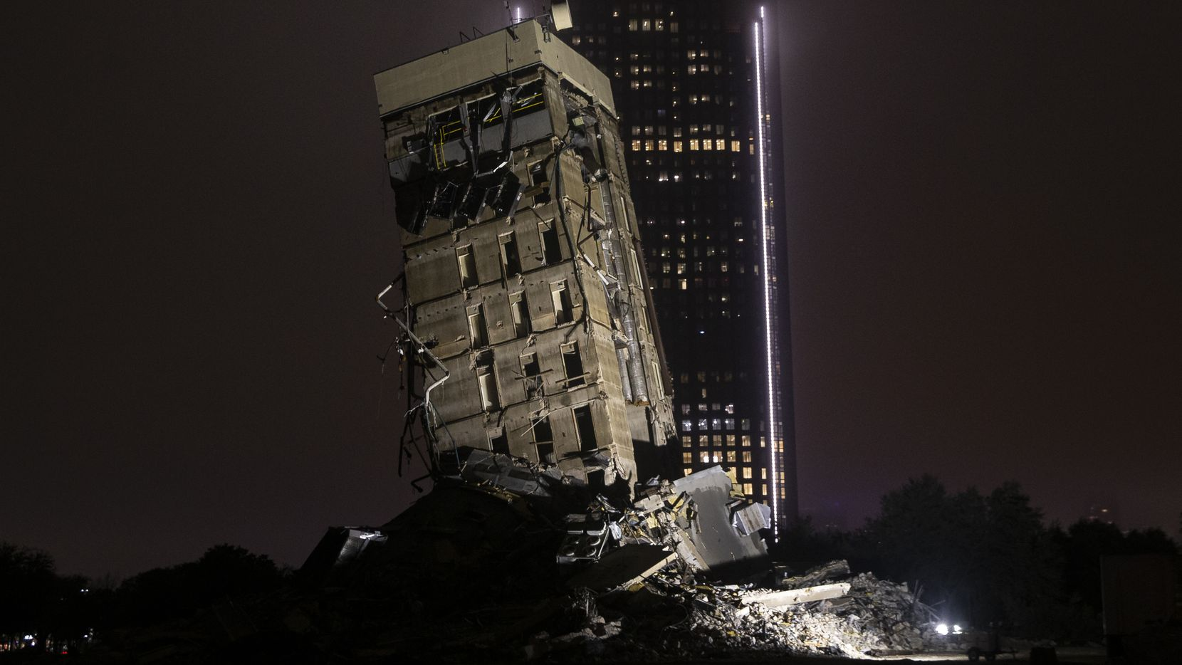 """""""The Leaning Tower of Dallas"""" photographed on its final night on Sunday, Feb. 23, 2020 in Dallas. The former Affiliated Computer Services building demolition is scheduled to take place between 9 a.m. and noon Monday."""
