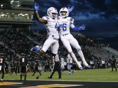 Duncanville wide receiver Christopher Thompson (4) is congratulated by his teammate Marquelan Crowell (6) after he caught a second quarter touchdown against Lancaster at Beverly D. Humphrey Tiger Stadium in Lancaster Texas, Friday, August 30, 2019.
