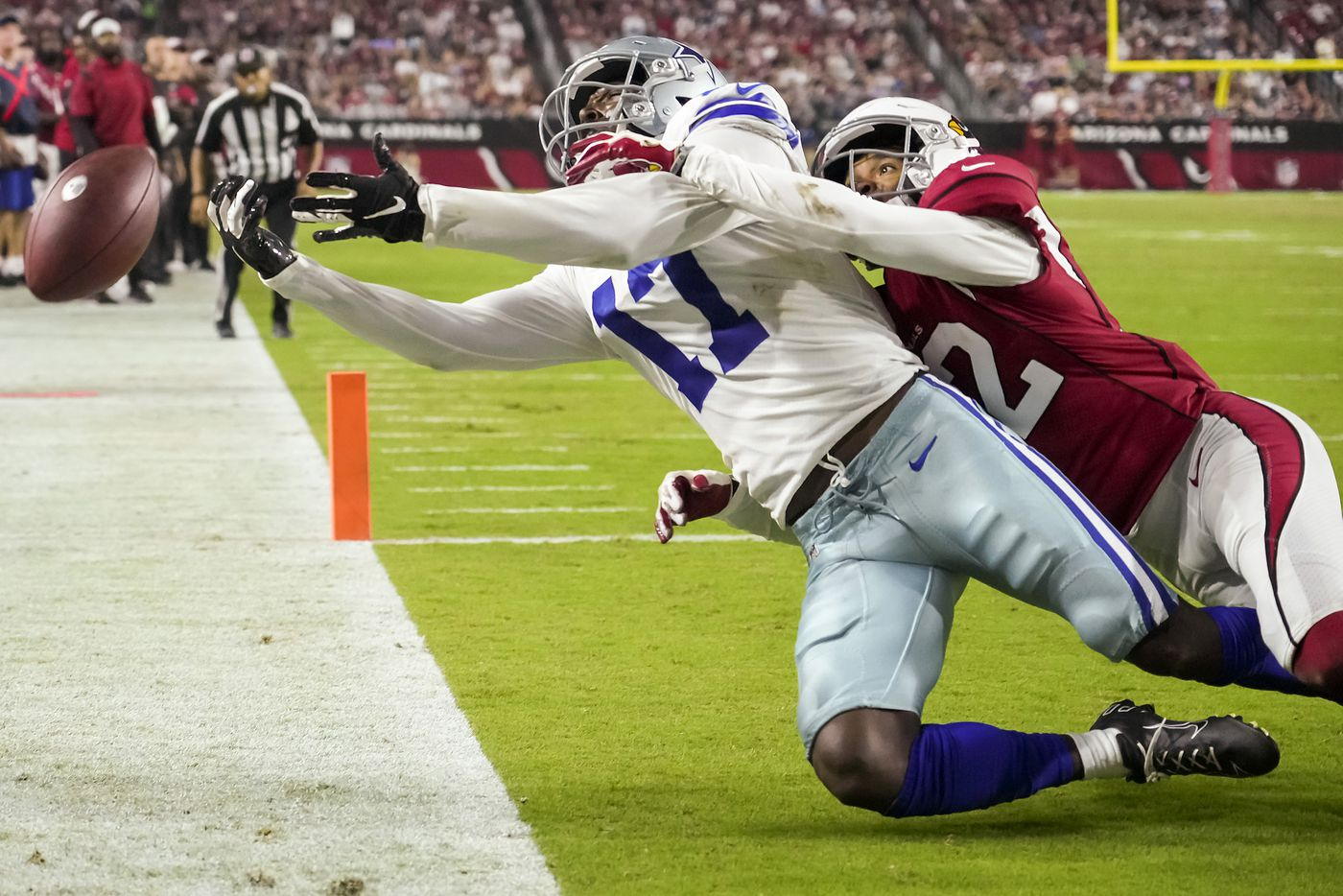 Dallas Cowboys wide receiver Malik Turner (17) can't catch a pass in the end zone as Arizona Cardinals cornerback Tay Gowan (32) defends during the second half of a preseason NFL football game at State Farm Stadium on Friday, Aug. 13, 2021, in Glendale, Ariz.