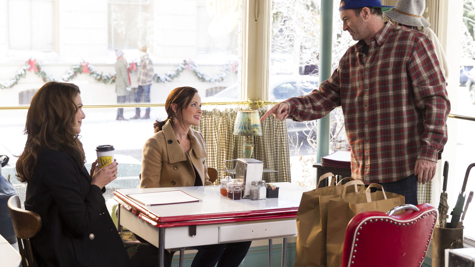 """Lauren Graham, Alexis Bledel and Scott Patterson play as Lorelai, Rory and Luke in a scene from Netflix's """"Gilmore Girls: A Year in the Life,"""" a 2016 miniseries which served as a sort of sequel to the popular 2000s TV show."""