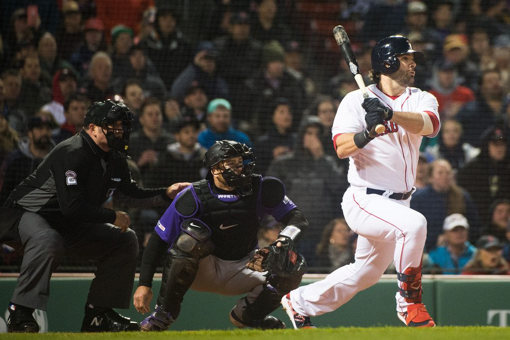 BOSTON, MA -  MAY 14: Mitch Moreland #18 of the Boston Red Sox hits a RBI single in the eighth inning against the Colorado Rockies at Fenway Park on May 14, 2019 in Boston, Massachusetts. (Photo by Kathryn Riley /Getty Images)