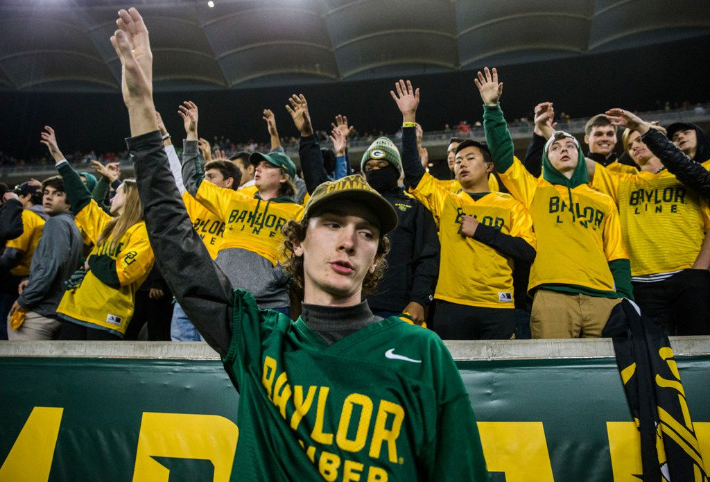 Baylor Bears fans sing the school song after losing 34-31 to the Oklahoma Sooners after an NCAA football game between Baylor University and Oklahoma University on Saturday, November 16, 2019 at McLane Stadium in Waco, Texas. (Ashley Landis/The Dallas Morning News)