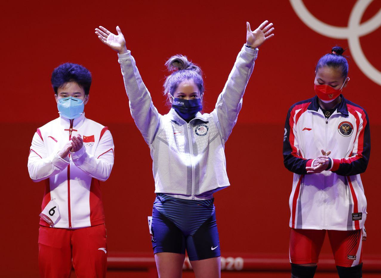 USA's Jourdan Delacruz waves as she is introduced during the women's 49 kg weightlifting final during the postponed 2020 Tokyo Olympics at Tokyo International Forum on Saturday, July 24, 2021, in Tokyo, Japan. (Vernon Bryant/The Dallas Morning News)