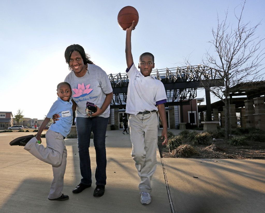 Chanelle Cook with her sons Matthew, 6, and Emmitt, 11, near their home in Buckeye Trail Commons in South Dallas. (Louis DeLuca/Staff Photographer)