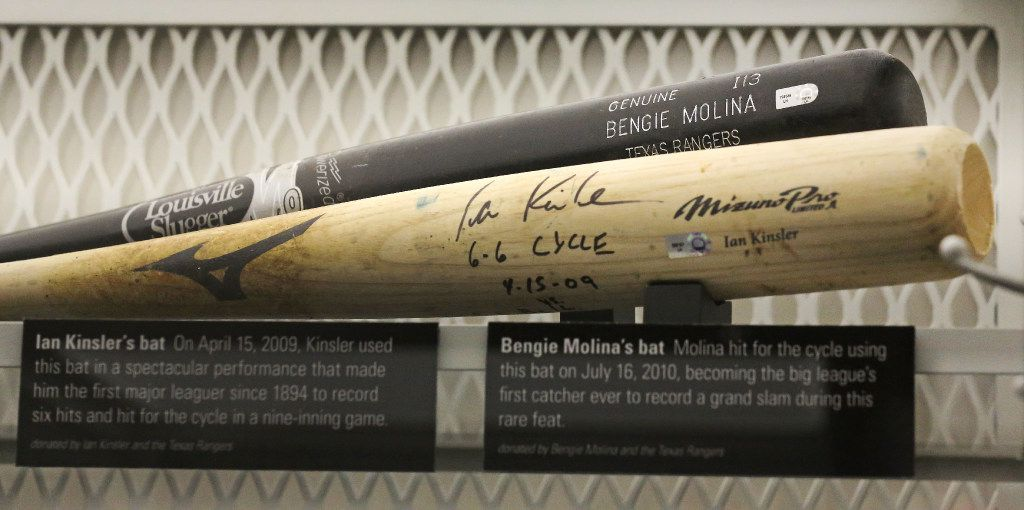 Bats from former Texas Rangers Bengie Molina and Ian Kinsler are on display in the Texas Rangers locker at the Baseball Hall of Fame in Cooperstown, NY, photographed on Tuesday, May 30, 2017. (Louis DeLuca/The Dallas Morning News)