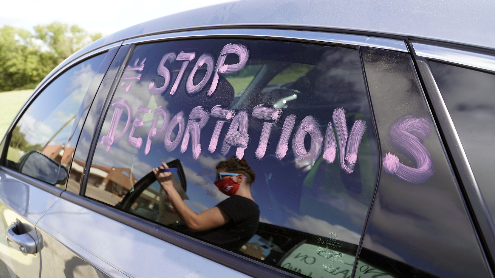 Immigrant advocates decorated their cars with signs in preparation to protest at the Prairieland Detention Center in Alvarado, Texas, on Thursday, October 22, 2020.