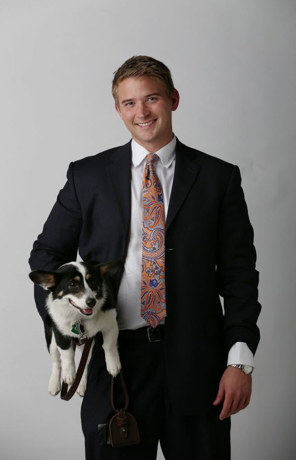 Criminal defense attorney Bryan Wilson stands for a portrait with his dog, Muffins