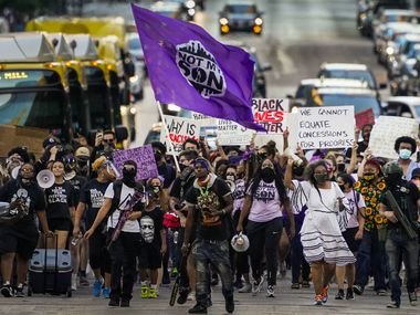 """Demonstrators march down Elm Street downtown during the Not My Son organization's """"100 Women March"""" from Dallas City Hall to the Frank Crowley Courts Building on Friday, July 31, 2020.  Protests that began in the response to the death of George Floyd in late May continued in Dallas as the calendar moves from July into August. (Smiley N. Pool/The Dallas Morning News)"""