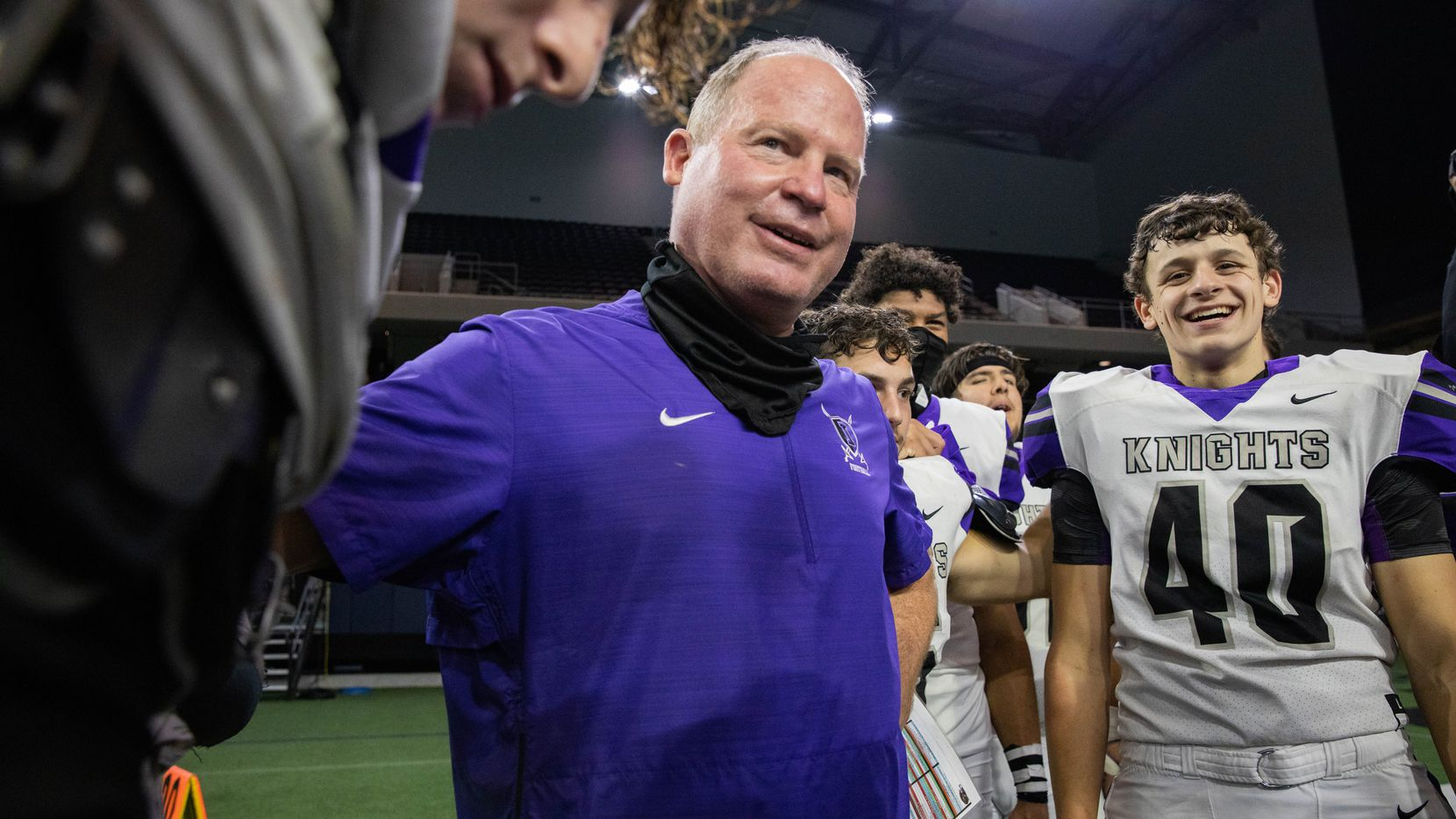 Frisco Independence football coach Kyle Story gathers to pray with his team following their win against Frisco Heritage at the Ford Center at the Star in Frisco on Thursday, Dec. 3, 2020.
