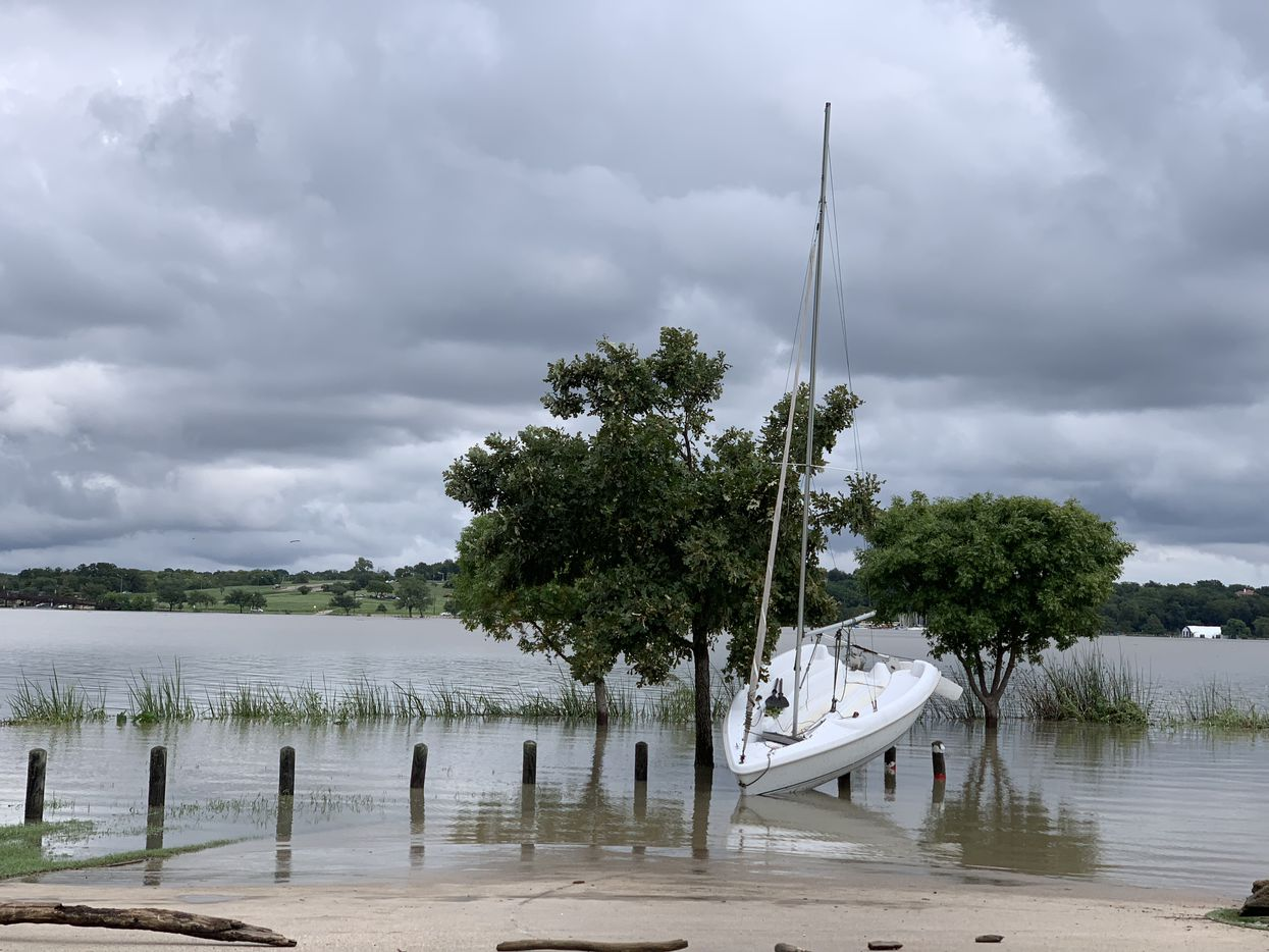 A sailboat washed up on the west shore of White Rock Lake in Dallas on Saturday.