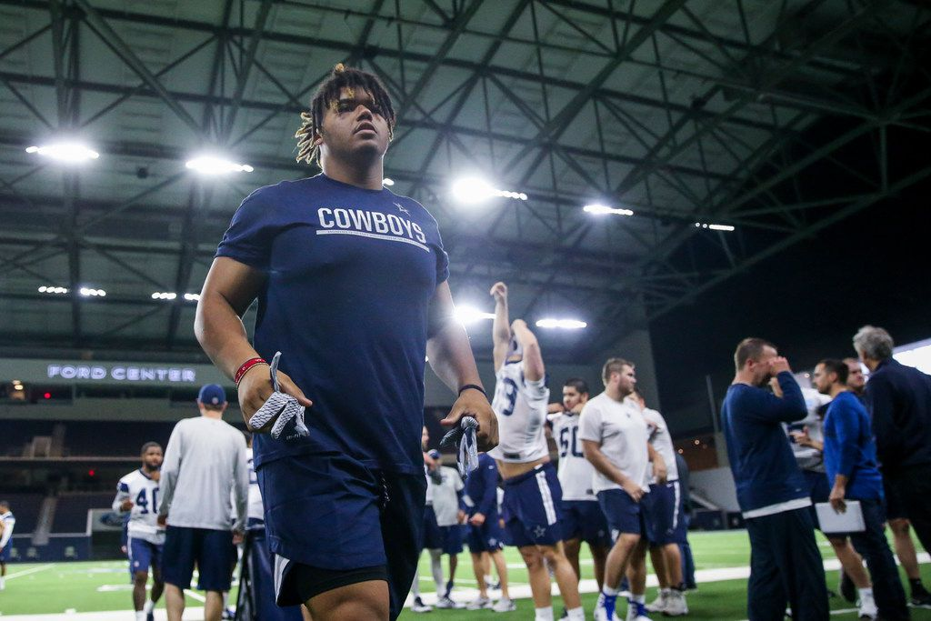 Dallas Cowboys defensive tackle Trysten Hill walks to the locker rooms following the Cowboys rookie minicamp practices at The Star in Frisco, Texas on Friday, May 10, 2019.(Shaban Athuman/Staff Photographer)