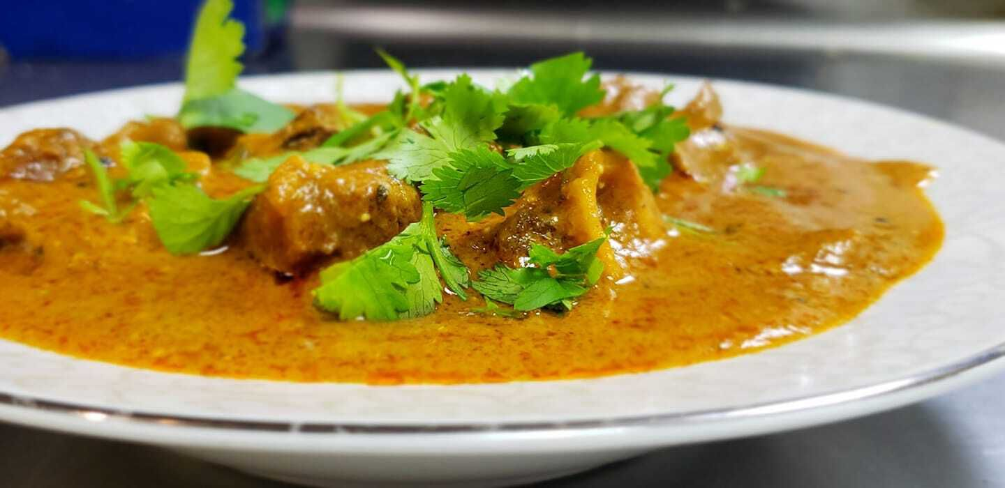 Oh My Curry sells several South Indian dishes, including spicy goat curry topped with cilantro.
