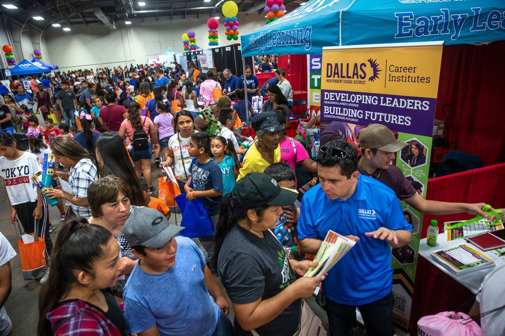Families attend the 23rd annual Mayor's Back to School Fair at the Fair Park Centennial Hall in Dallas on Friday, Aug. 2, 2019. Thousands of children and their family members were expected to attend, and the event included health and eye screenings, dental screenings, backpack giveaways and more.