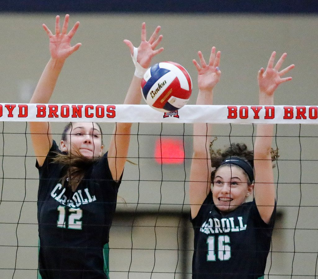 Southlake middle Annabelle Smith (12) goes up with right side Laura Brambilla (16) to attempt a block during game one as McKinney Boyd High School hosted Southlake Carroll High School in a volleyball match on Tuesday, August 28, 2018.  (Stewart F. House/Special Contributor)
