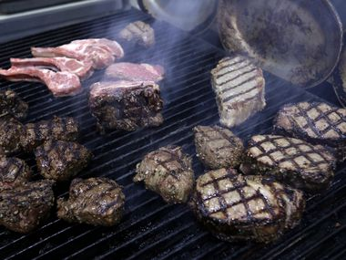 People are buying and putting together backyard grills.