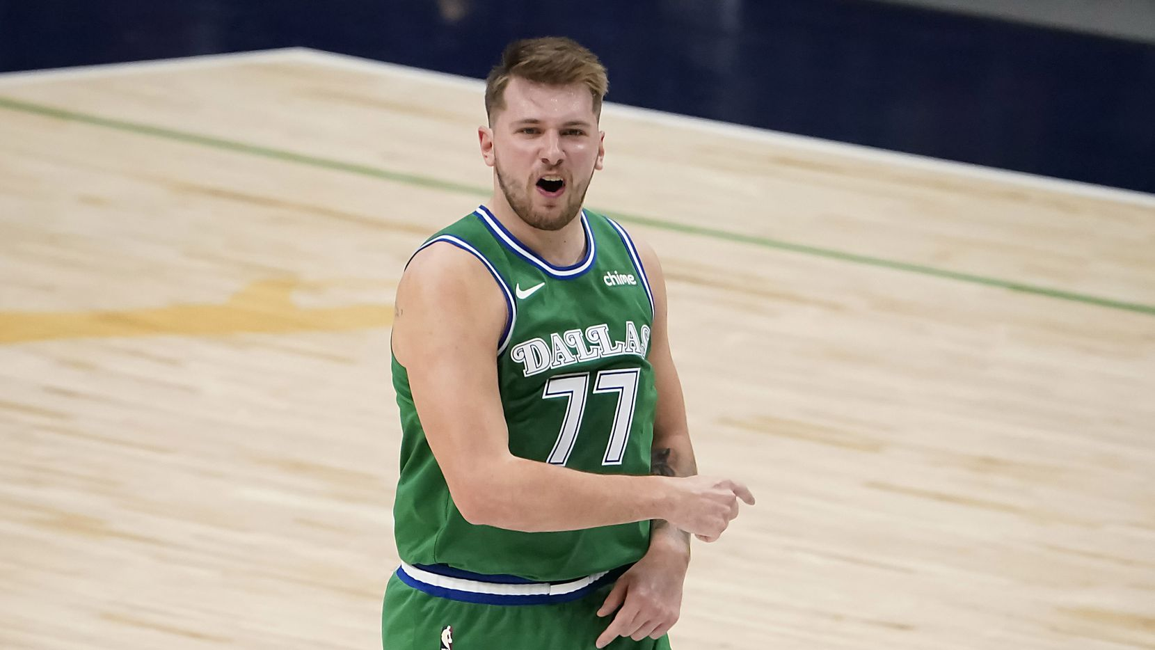 Dallas Mavericks guard Luka Doncic (77) celebrates after hitting a 3-pointer during the during the second half of an NBA basketball game against the LA Clippers at American Airlines Center on Wednesday, March 17, 2021, in Dallas.