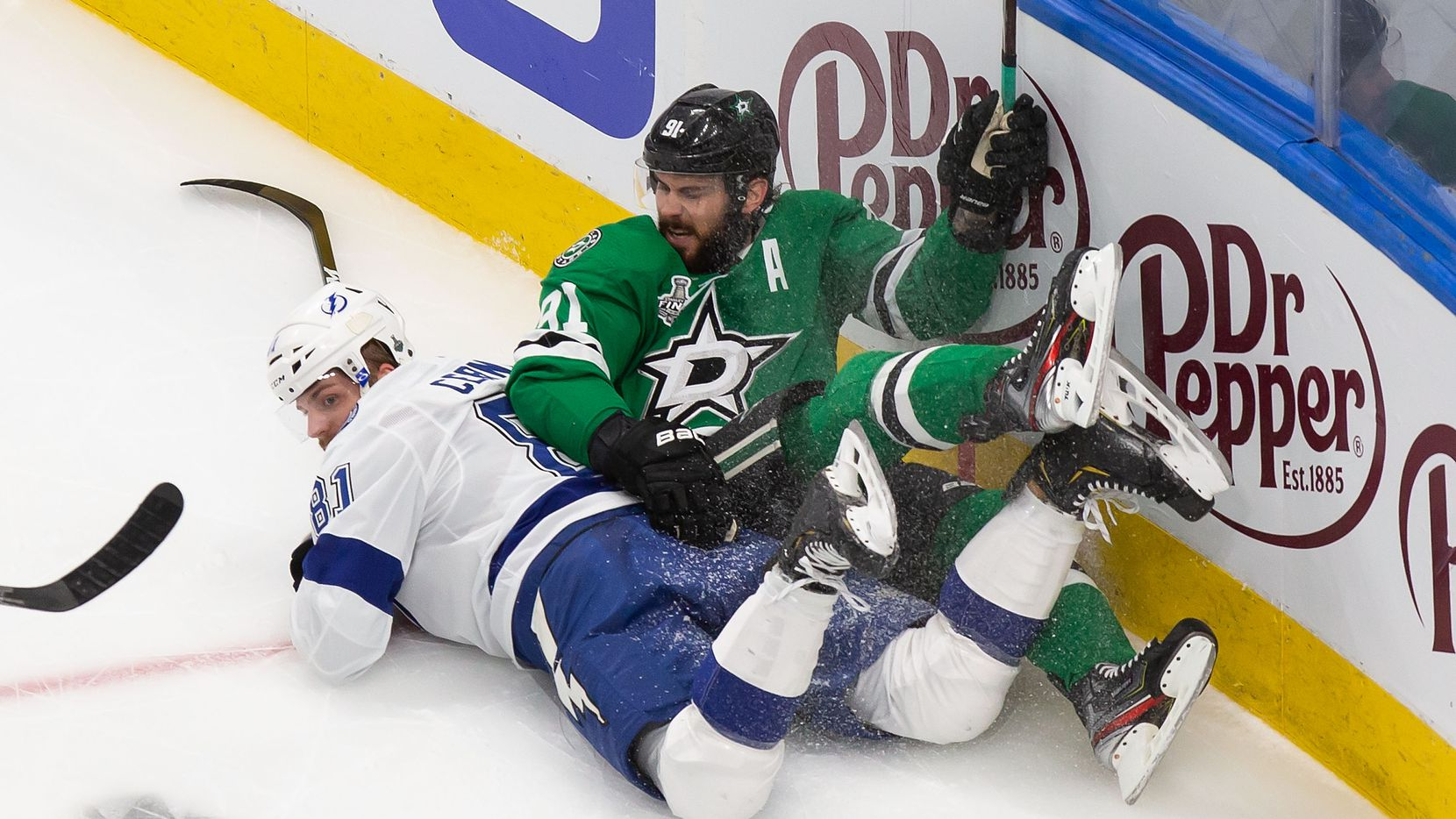 Tyler Seguin (91) of the Dallas Stars collides with Erik Cernak (81) of the Tampa Bay Lightning during Game Six of the Stanley Cup Final at Rogers Place in Edmonton, Alberta, Canada on Monday, September 28, 2020.