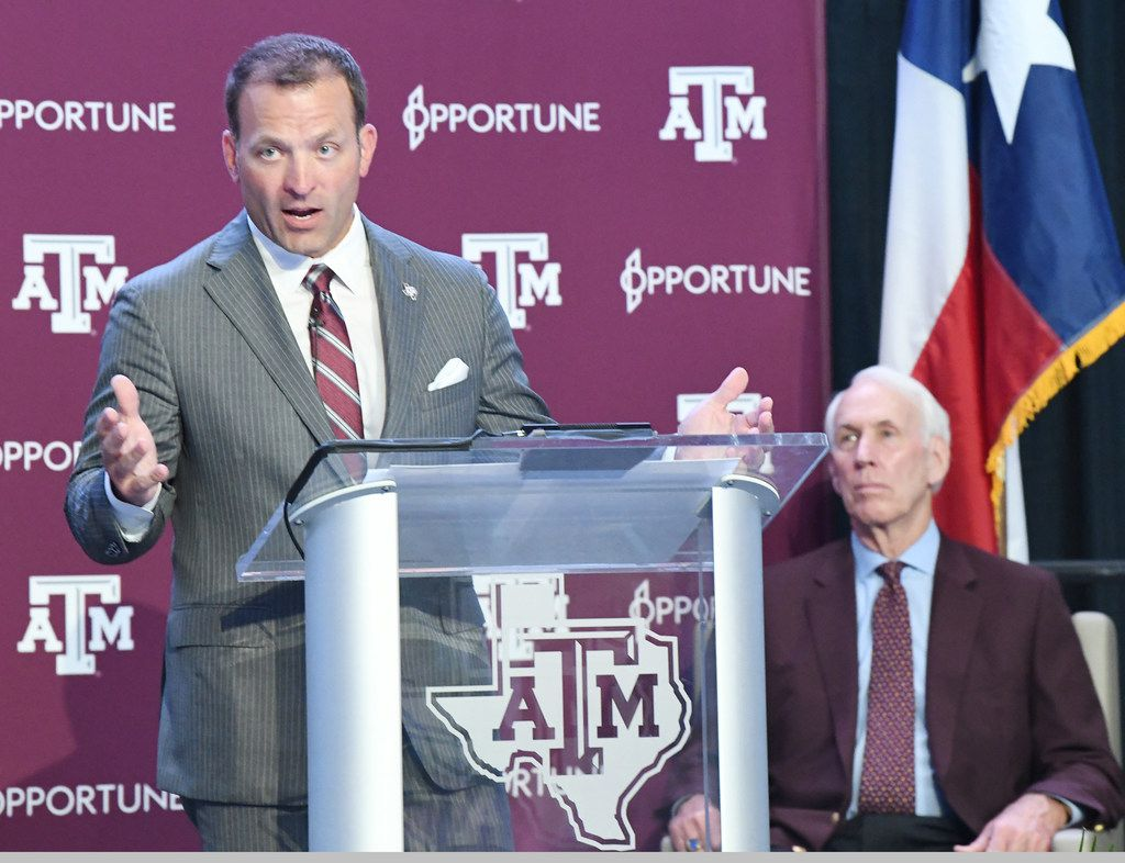 Texas A&M AD Ross Bjork addresses media and A&M athletic staff in the Hall of Champions at Texas A&M in College Station on Monday, June 3, 2019, as interim AD R.C. Slocum (right) looks on.