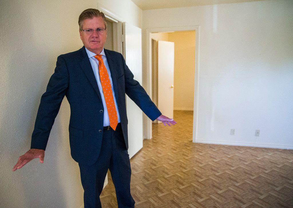 Developer Ruel Hamilton shows off a renovated unit at Good Haven Apartments. (Ashley Landis/Staff Photographer)