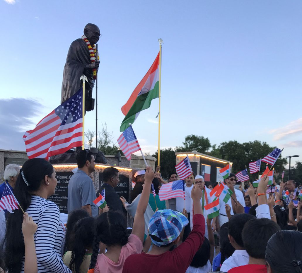 Waving flags at the celebration of India's Independence Day at the Mahatma Gandhi Memorial in Irving.