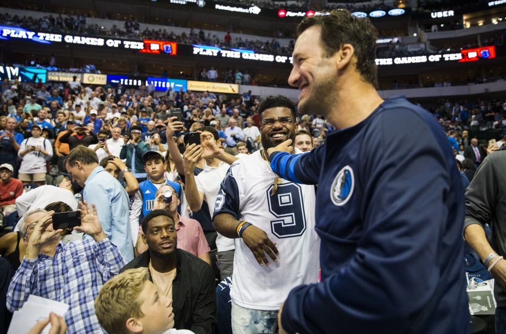 Former Dallas Cowboys quarterback Tony Romo teases Dallas Cowboys running back Ezekiel Elliott before an NBA game between the Dallas Mavericks and the Denver Nuggets on Tuesday, April 11, 2017 at the American Airlines Center in Dallas. Romo was an honorary Mavericks team member. (Ashley Landis/The Dallas Morning News)