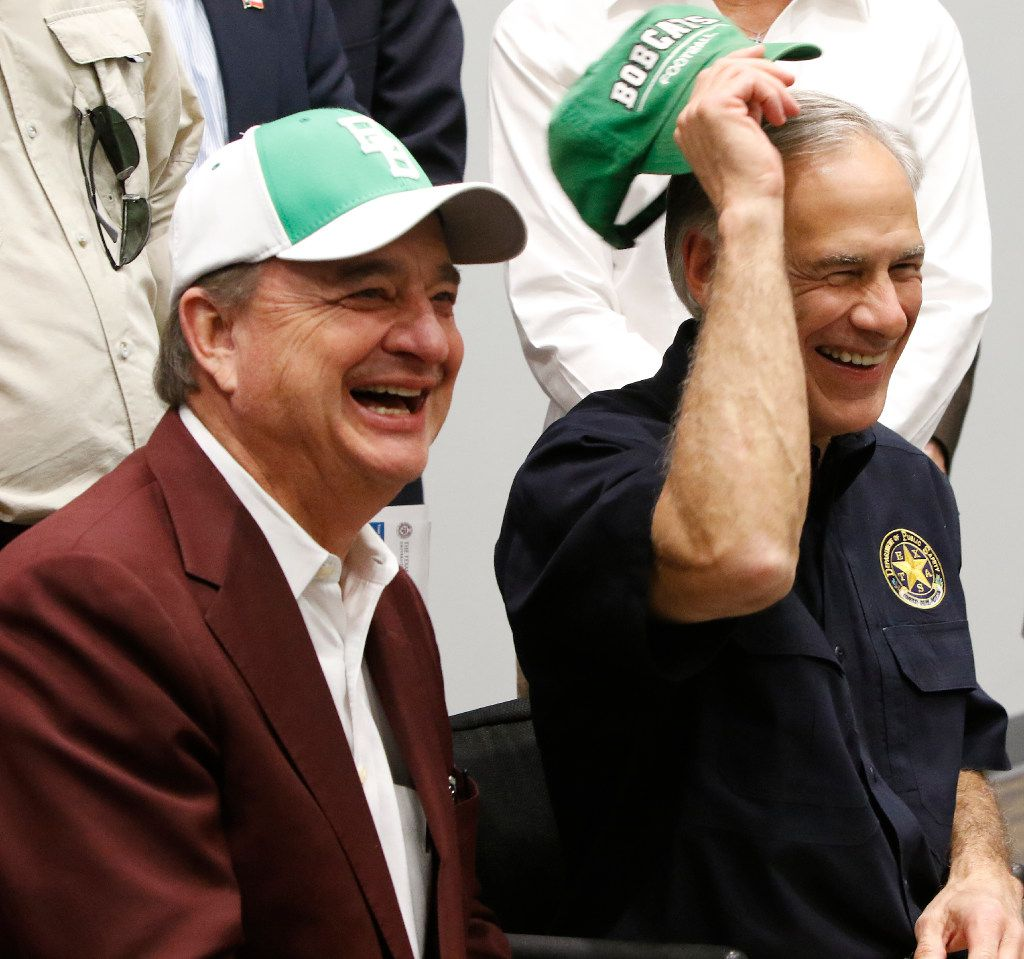 Gov. Greg Abbott, right, and John Sharp, left, have faced challenges -- and some opportunities -- in responding to Hurricane Harvey. Abbott named Sharp, chancellor of the Texas A&M University System, to head the Governor's Commission to Rebuild Texas. (2017 File Photo/Irwin Thompson)