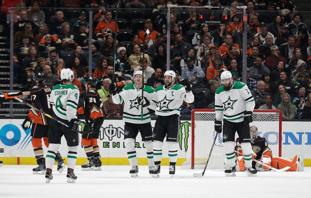 Dallas Stars' Miro Heiskanen, left (4), celebrates his goal with teammates during the second period of an NHL hockey game against the Anaheim Ducks Wednesday, Dec. 12, 2018, in Anaheim, Calif. (AP Photo/Marcio Jose Sanchez)
